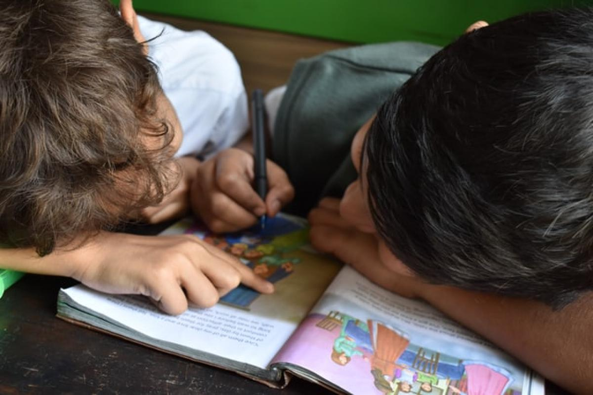 Two school children studying image